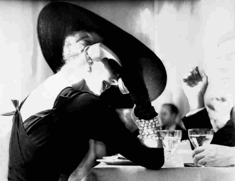 Lillian Bassman's photograph The V‐Back Evenings shows model and actress Suzy Parker having a drink (and some fun) in 1955.