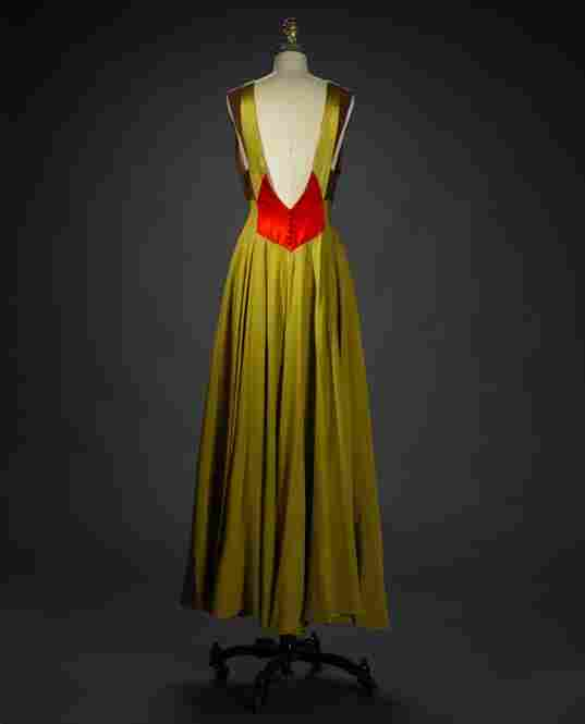 Evening dress, ca. 1950, by Philip HulitarNylon, acetate, cotton, gauze weave, Alencon-type machine lace, hand appliqued