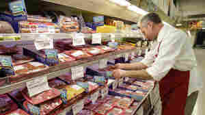 Kevin Morlan arranges packages of pork at a local Dahl's grocery store in Des Moines, Iowa. Economists are predicting meat prices will rise 7 percent this year.