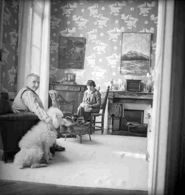 Gertrude Stein and Alice B. Toklas in wallpapered room, 1938