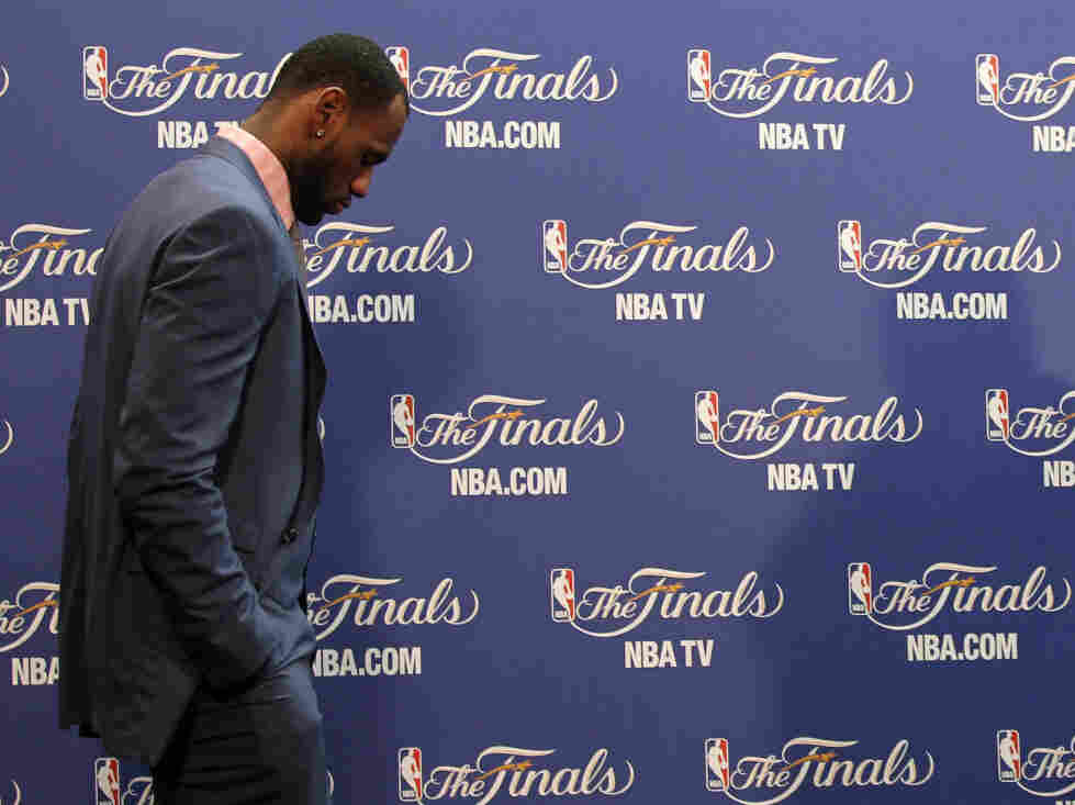 LeBron James enters the interview room.