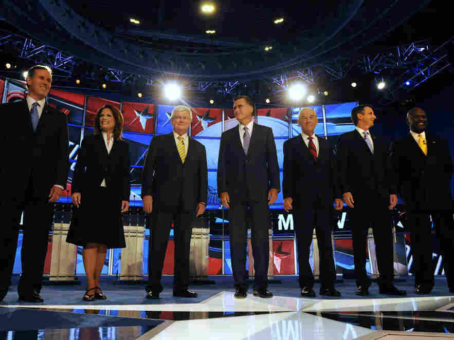 Republican candidates (L to R) former U.S. Sen. Rick Santorum (PA), U.S.  Rep. Michele Bachmann (MN), former House Speaker Newt Gingrich, former  Governor Mitt Romney (MA), U.S. Rep. Ron Paul (TX), former Governor Tim  Pawlenty (MN), and businessman Herman Cain prepare for their debate June  13, 2011 at Saint Anselm College in Manchester, New Hampshire.