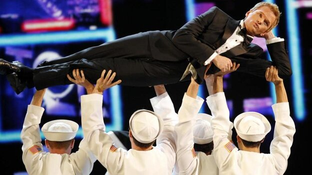 Host Neil Patrick Harris is held aloft by some helpful sailors in the opening number of the 2011 Tony Awards telecast.