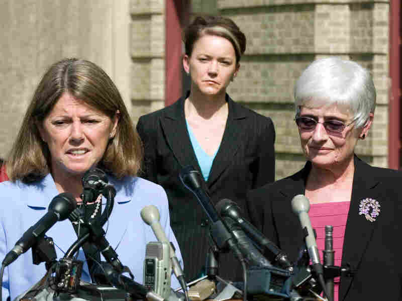 Rhode Island Education Commissioner Deborah Gist, (center) looks on as Central Falls School Superintendent Frances Gallo (right) and Central Falls Teachers' Union President Jane Sessums (left) talk to the media just after the union approved an agreement allowing the entire staff to be rehired last May.
