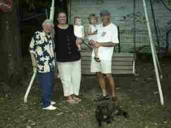 Debbie Elliott (second from left) with Katherine Tucker Windham (left) and Elliott's husband and two children.