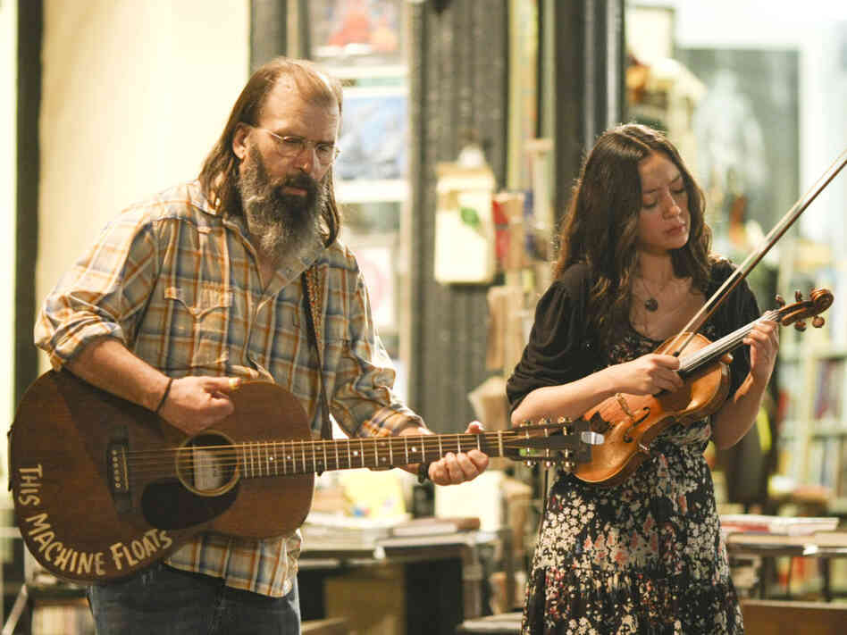 Harley (Steve Earle, left) and Annie (Lucia Micarelli) busk in the French Quarter in Treme.