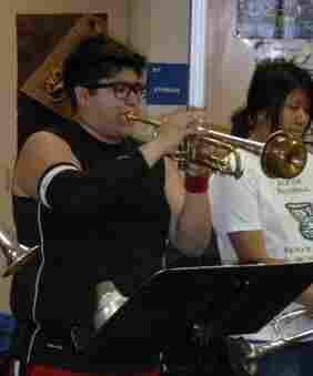 Walter Cano practices the trumpet for Jackson High School's jazz band.
