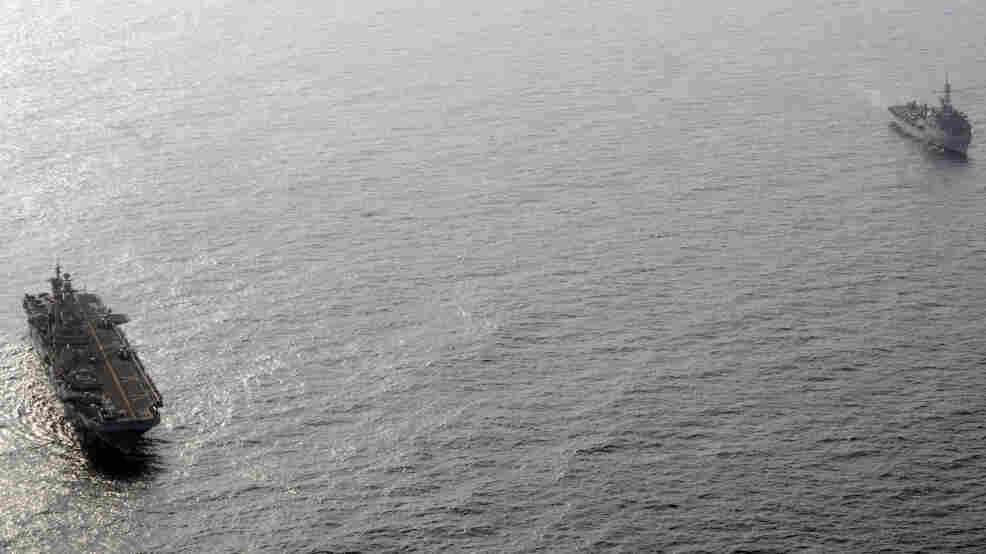 The amphibious assault ship USS Peleliu (L) and the amphibious transport dock ship USS Dubuque in the Arabian Sea off the coast of Pakistan.