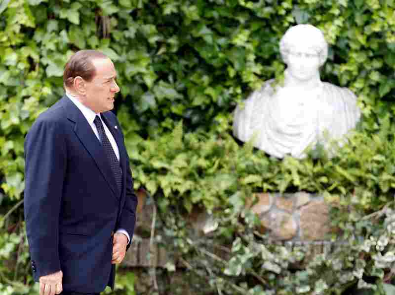 Italian Prime Minister Silvio Berlusconi arrives for a bilateral meeting with Israeli Prime Minister Benjamin Netanyahu in Rome on Monday. Italian voters dealt Berlusconi a serious political blow, overturning laws passed by his government to revive nuclear energy, privatize the water supply and help him avoid prosecution.