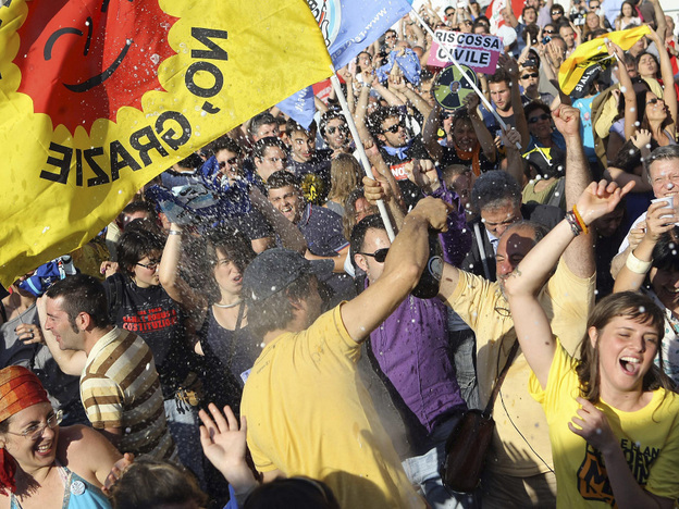 People celebrate the results in Italian referendums on water and nuclear power in Rome on Monday.