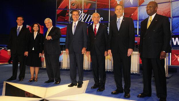 Left to right: Former Sen. Rick Santorum; Rep. Michele Bachmann; former House Speaker Newt Gingrich; former Massachusetts Gov. Mitt Romney; Rep. Ron Paul; former Minnesota Gov. Tim Pawlenty; entrepreneur Herman Cain.