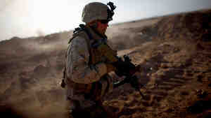 Sgt. Joseph Garrison with Fox Company, 2nd Battalion, 8th Marine Regiment, runs through the desert near Camp Leatherneck during a drill in June 2009. Garrison was killed while on his fourth combat deployment to Afghanistan in June 2011, when he