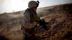 Sgt. Joseph Garrison with Fox Company, 2nd Battalion, 8th Marine Regiment, runs through the desert near Camp Leatherneck during a drill in June 2009. Garrison was killed while on his fourth combat deployment to Afghanistan in June 2011, when he was struck by a homemade bomb in Marjah.
