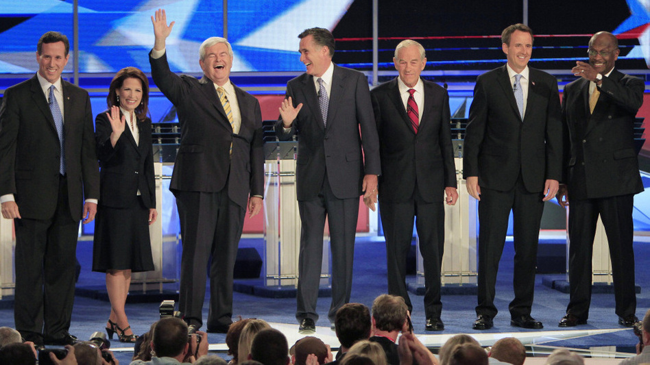 Seven Republican presidential hopefuls stand onstage before their first debate Monday, at St. Anselm College in Manchester, N.H. From left are former Pennsylvania Sen. Rick Santorum, Minnesota Rep. Michele Bachmann, ex-House Speaker Newt Gingrich, former Massachusetts Gov. Mitt Romney, Texas Rep. Ron Paul, ex-Minnesota Gov. Tim Pawlenty and businessman Herman Cain.