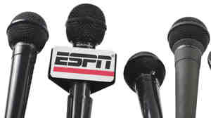 Five microphones and an ESPN mic flag.