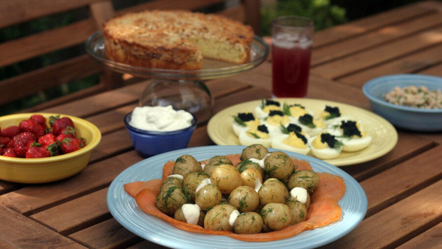 A Misdsommar Feast Spread On Picnic Table Includes Cake And Strawberries New Potatoes