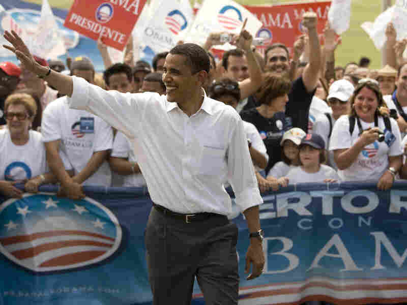 Then-Democratic presidential hopeful Barack Obama waves during a May 24, 2008, campaign stop in San Juan, Puerto Rico. Keeping a campaign promise, Obama returns Tuesday.