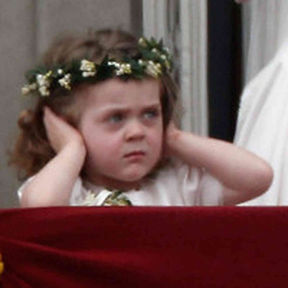 Perhaps it wasn't just the crowd noise that was bothering little Grace van Cutsem on the balcony of Buckingham Palace.