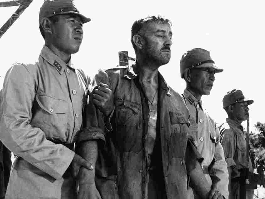 "Alec Guinness, center, is shown in a scene from the film ""Bridge on the River Kwai."""