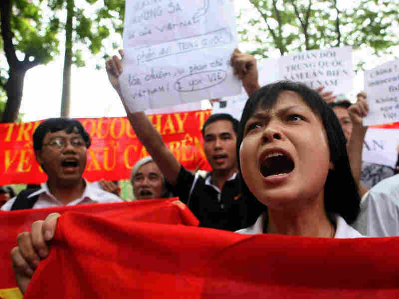 Protesters shout anti-China slogans in front of the Chinese Embassy in the Vietnamese capital, Hanoi, on Sunday.