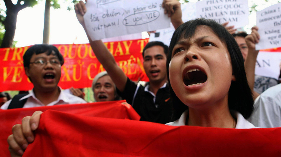Protesters shout anti-China slogans in front of the Chinese Embassy in the Vietnamese capital, Hanoi, on Sunday. (AFP/Getty Images)