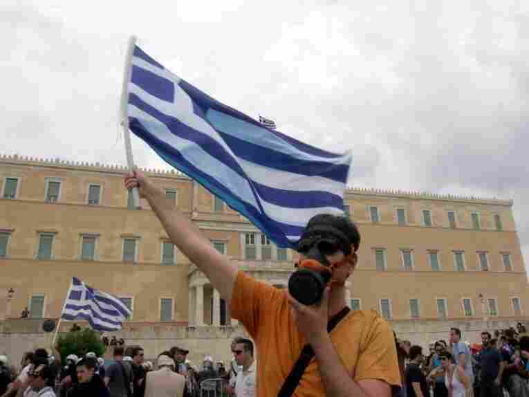 A demonstrator in front of Parliament.