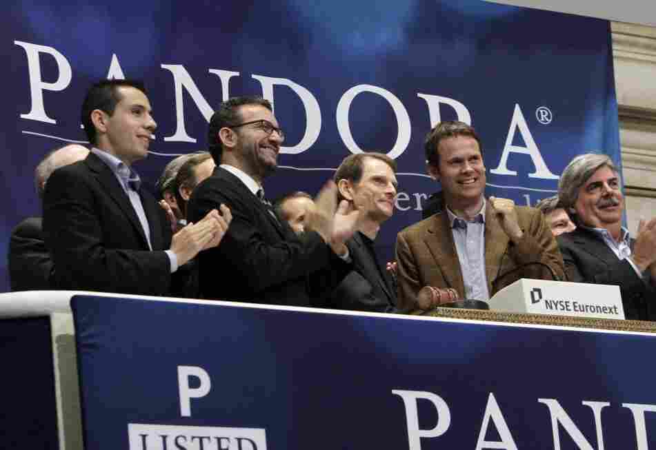 Joe Kennedy, third from left, CEO & President, and Tim Westergren, fourth from left, Chief Strategy Officer & Founder, of Pandora internet radio at the NYSE ringing the opening bell.