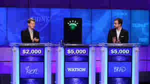 Contestants Ken Jennings, Brad Rutter and IBM's computer named Watson compete on Jeopardy! earlier this year.