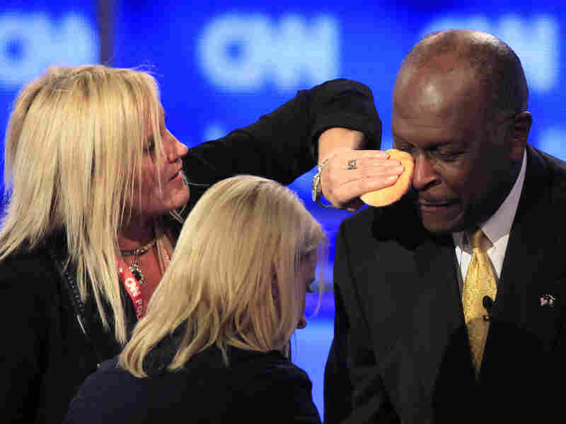 Businessman Herman Cain has some powder applied during a break in the first New Hampshire Republican presidential debate at St. Anselm College in Manchester. Many pundits are unimpressed with the candidates' performances at the debate.