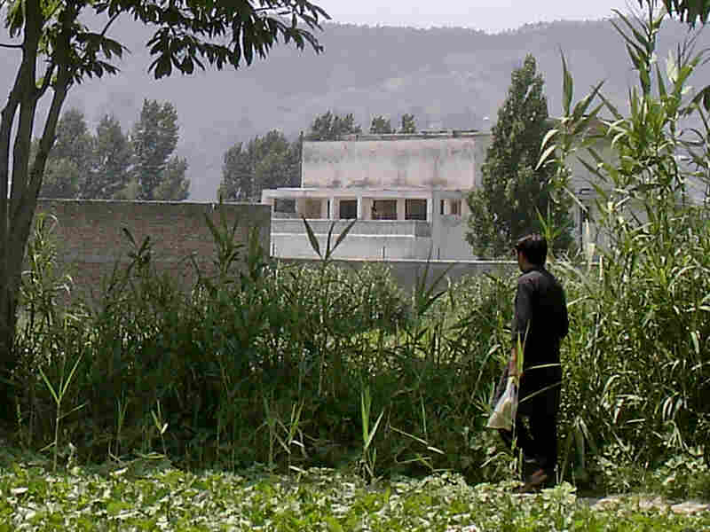 A local resident walks Wednesday near Osama bin Laden's compound in Abbottabad, Pakistan. The U.S. raid that killed bin Laden has been a source of tension in U.S.-Pakistani relations.