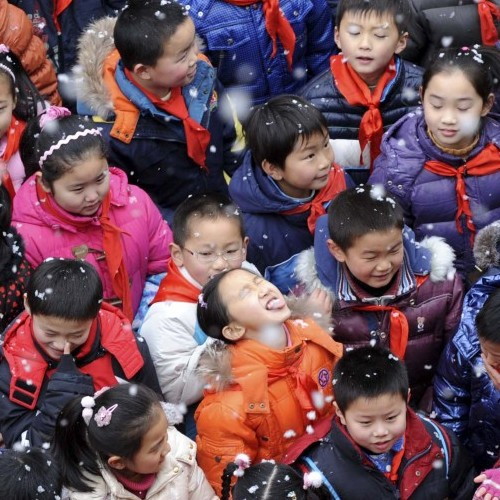 School children celebrate snowfall in Nanjing in eastern China's Jiangsu province. The rise of an educated and wealthy clientele in many Asian countries has made  sex-selective abortion more common.