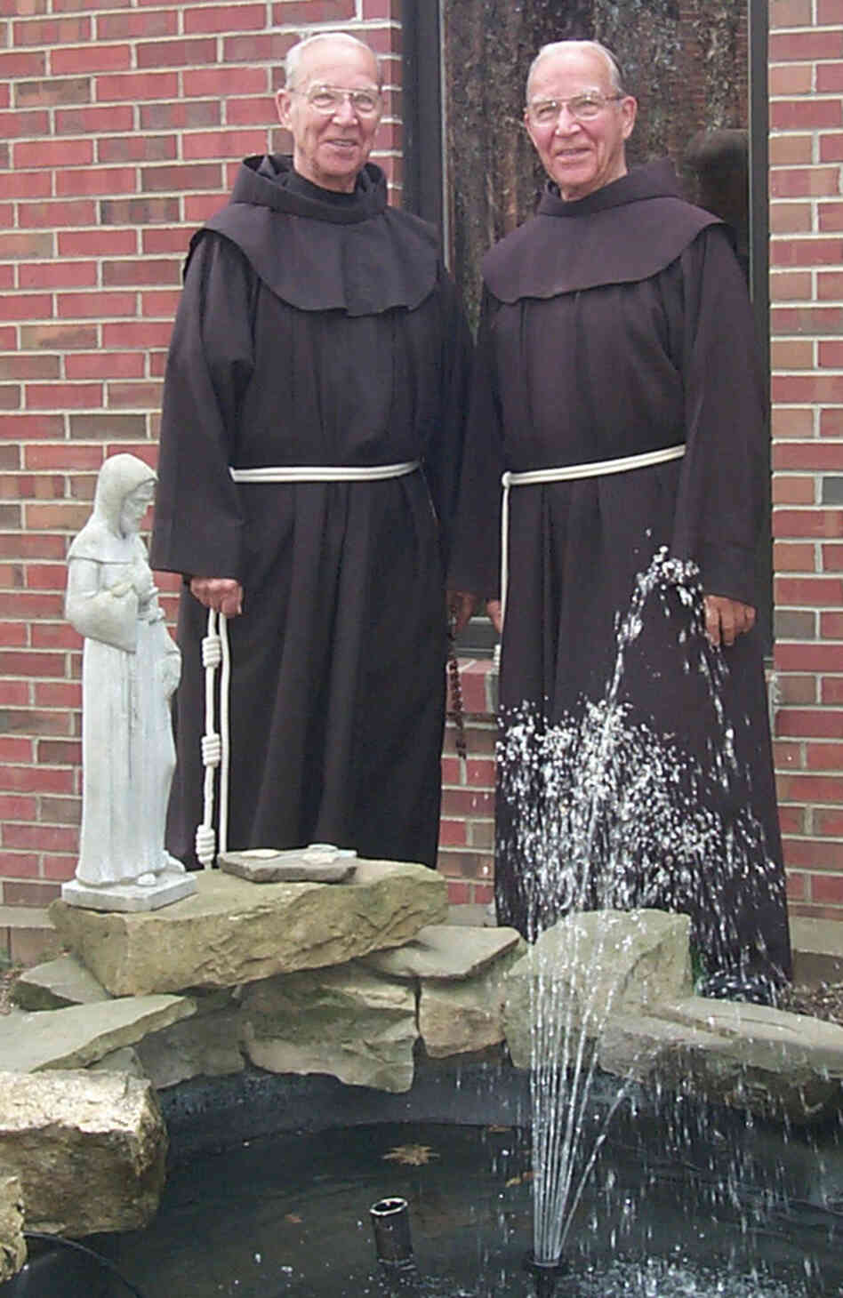 May 2003 photo provided by St. Bonaventure University of shows Adrian, left, and Julian Riester, identical twins and brothers in the Order of Friars Minor.