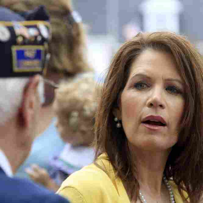 Rep. Michele Bachmann talks with veterans after marching in a Memorial Day parade, Monday, May 30, 2011 in North Hampton, N.H.