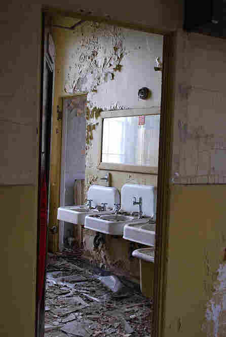 The National Soldiers Home is badly deteriorating. Above, water damage in a restroom at Ward Theater.