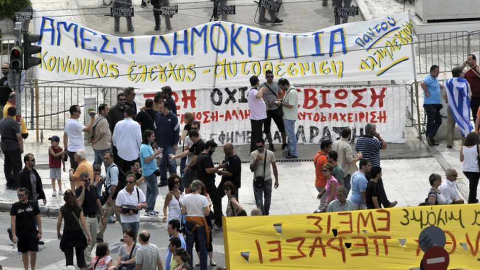 Protesters in Athens gather in front of the Greek Parliament as riot police stand guard Wednesday.