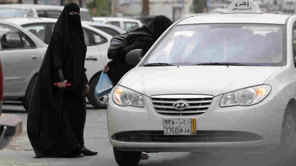 Saudi women enter a taxi in Riyadh, Saudi Arabia, in May.