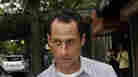Rep. Anthony Weiner, D-N.Y., carries his laundry to a laundromat near his home in New York, June 11, 2011.