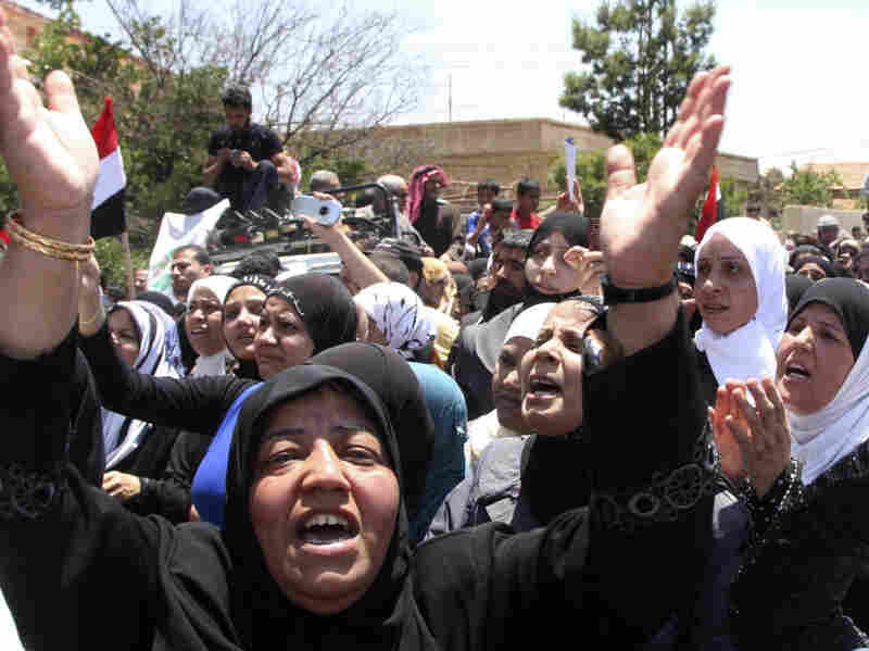 Palestinian women react during a funeral procession for Palestinian protesters killed by Israeli soldiers near Damascus, Syria on June 6. In a country already in the middle of war, some fear the fake blog Gay Girl in Damascus could endanger more people.