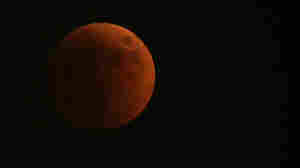 The moon was turned red during the eclipse, as this view from Skopje, Macedonia, shows.