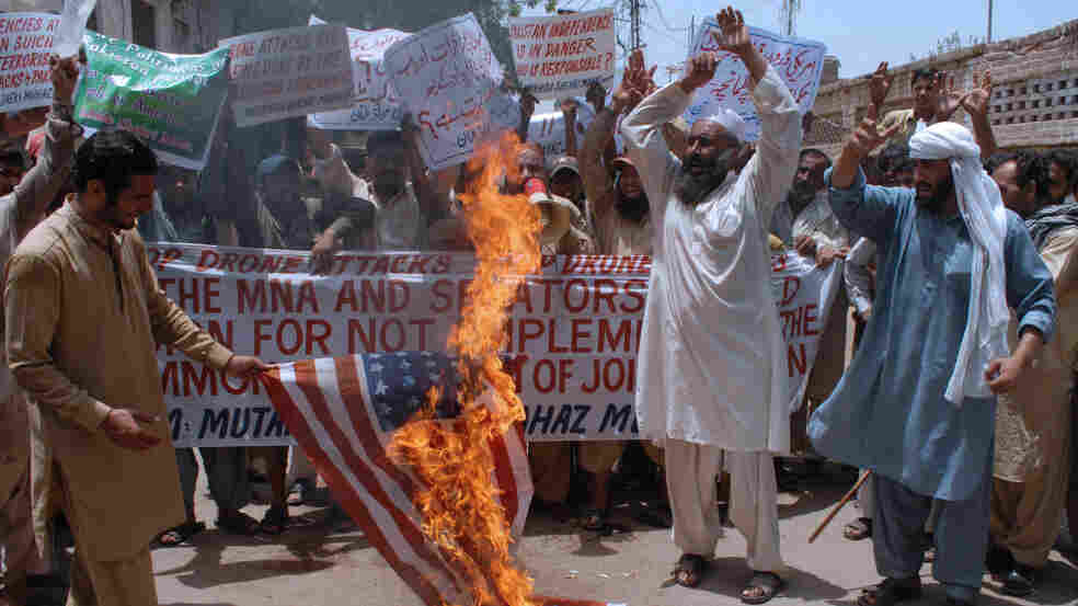 Activists of Pakistan Mutahida Shehri Mahaz burn a U.S. flag during a protest in Multan on June 16, 2011, against U.S. drone attacks. Fifteen drone strikes have now been reported in Pakistan's tribal belt since U.S. commandos found and killed Al-Qaeda chief Osama bin Laden.