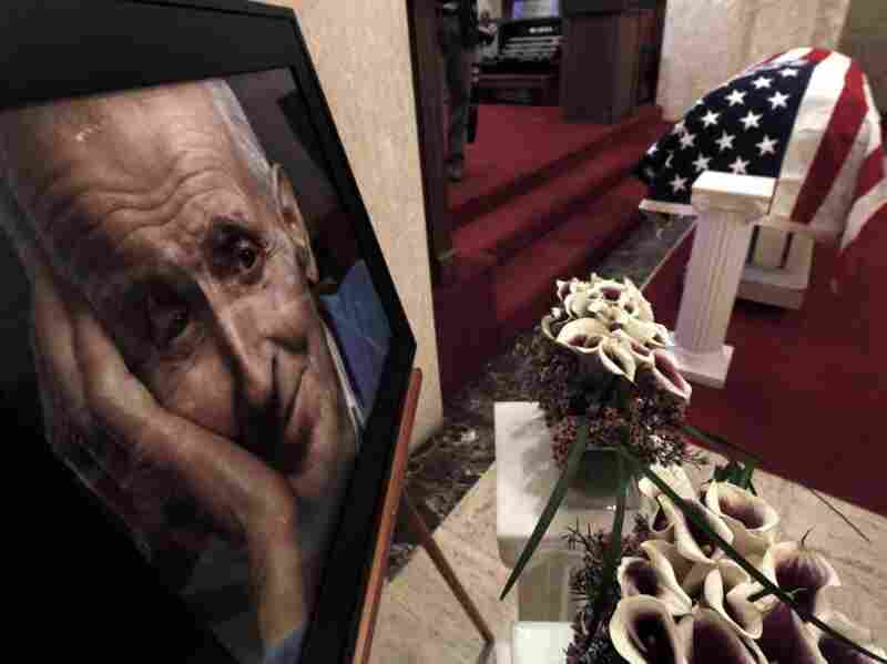 A photo of Dr. Jack Kevorkian is shown next to his casket after a public memorial service in Troy, Mich. on June 10. Kevorkian, who died on June 3, was an advocate of assisting the gravely-ill in dying and claimed he assisted in about 130 deaths. He spent eight years in prison for second-degree murder after 60 Minutes broadcast video of him helping someone die in 1998.