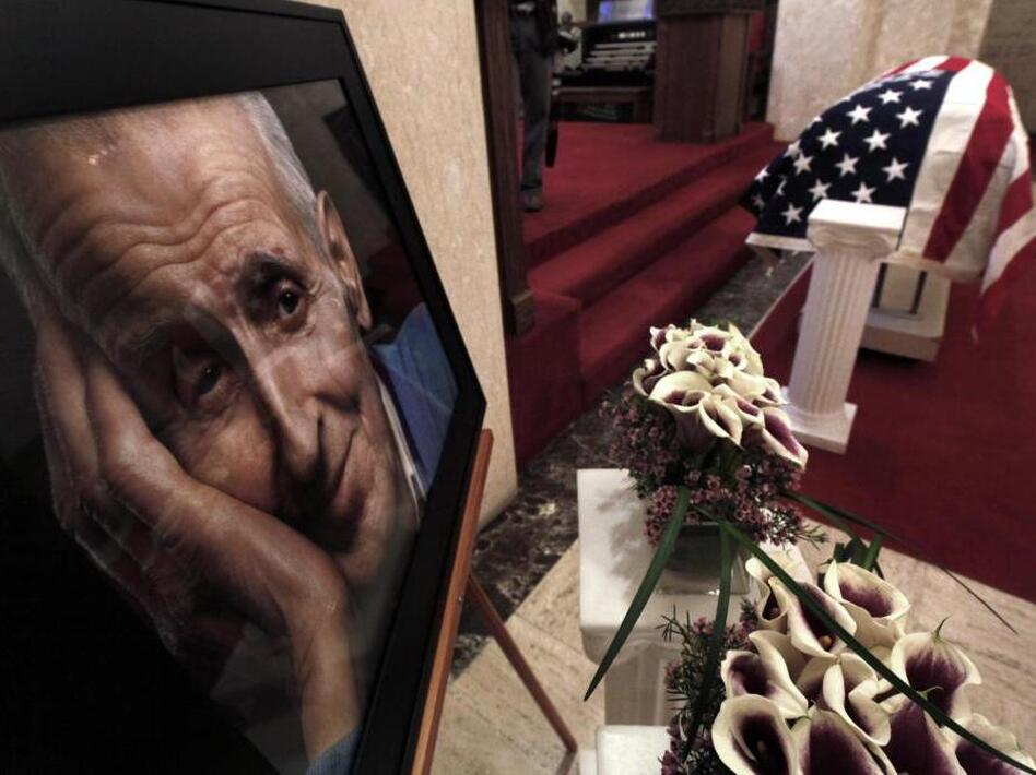 A photo of Dr. Jack Kevorkian is shown next to his casket after a public memorial service in Troy, Mich. on June 10. Kevorkian, who died on June 3, was an advocate of assisting the gravely-ill in dying and claimed he assisted in about 130 deaths. He spent eight years in prison for second-degree murder after <em>60 Minute</em>s broadcast video of him helping someone die in 1998. (Paul Sancya/AP)