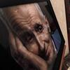 A photo of Dr. Jack Kevorkian is shown next to his casket after a public memorial service in Troy, Mich. on June 10. Kevorkian, who died on June 3, was an advocate of assisting the gravely-ill in dying and claimed he assisted in abou