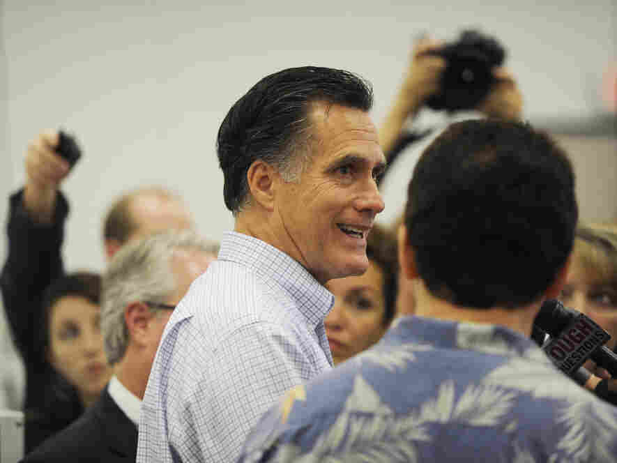 Mitt Romney takes news media questions from the media after