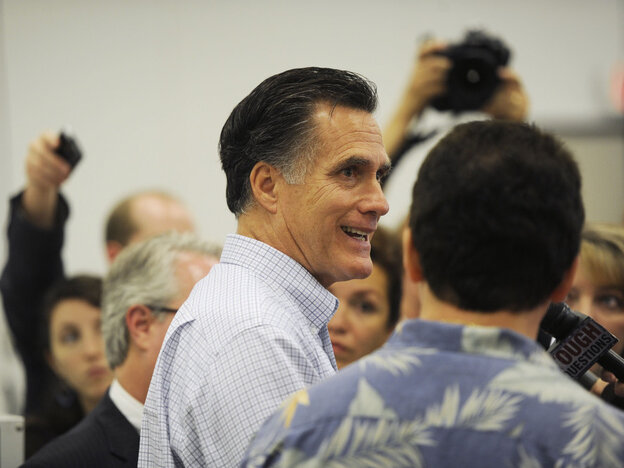 Mitt Romney takes news media questions from the media after touring the small business in Smyrna, Ga., Thursday, June 16, 2011.