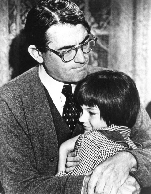"Gregory Peck embraces Mary Badham, 9, a Birmingham Alabama acting discovery who plays his daughter in ""To Kill a Mockingbi"
