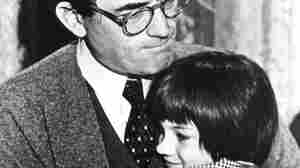 """Gregory Peck embraces Mary Badham, 9, a Birmingham Alabama acting discovery who plays his daughter in """"To Kill a Mockingbird""""  March 1963."""