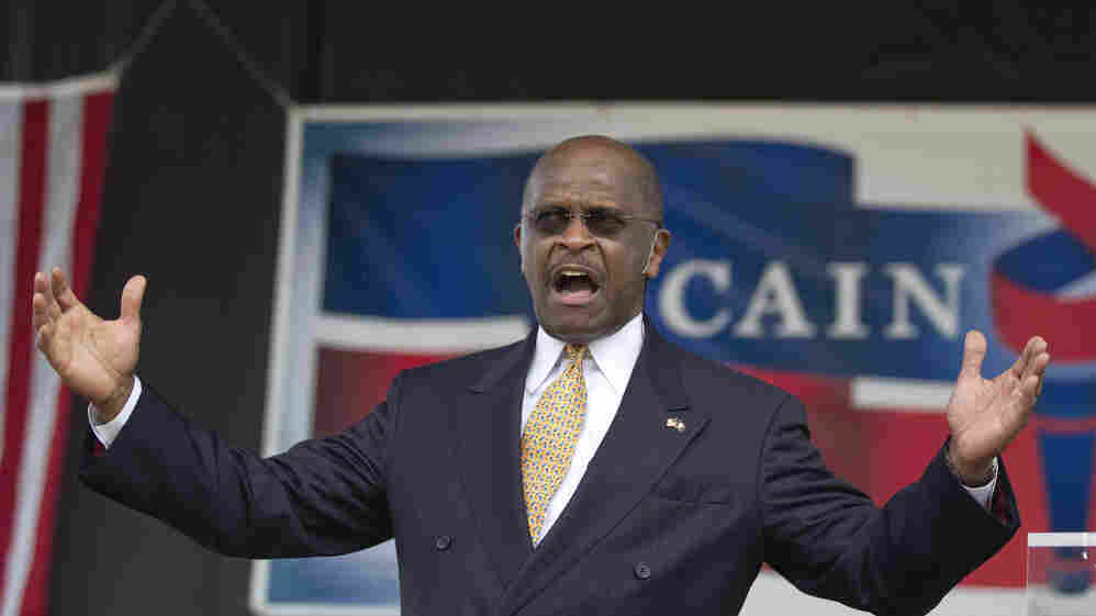 Herman Cain announces his run for Republican candidate for president at a rally in Atlanta, May 21, 2011.