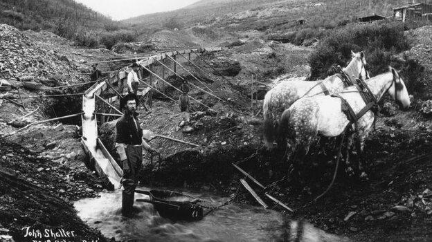 Nineteenth-century prospectors pan for gold in the Klondike region of Canada's Yukon Territory.