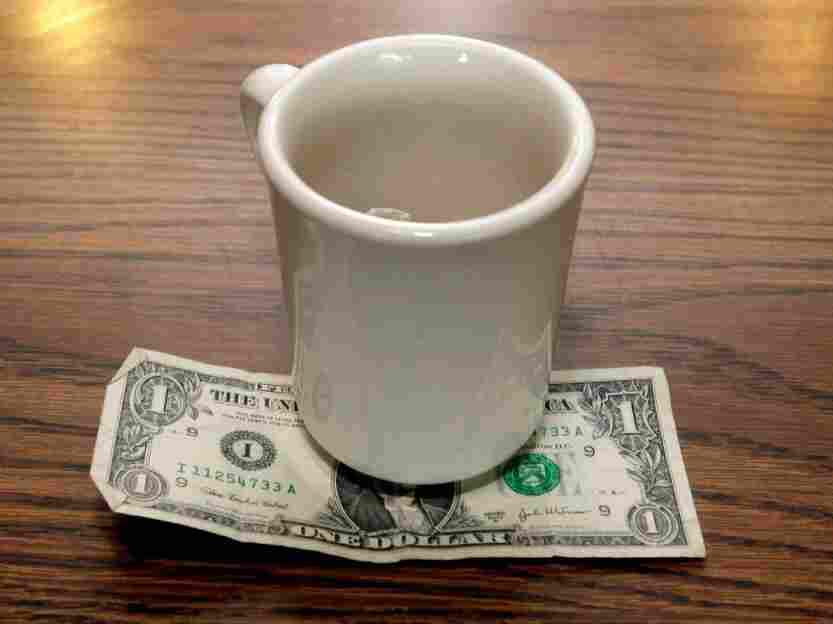 A tip is left by a customer at Linda's Place Restaurant in St. Clair Shores, Mich., Thursday, June 19, 2008